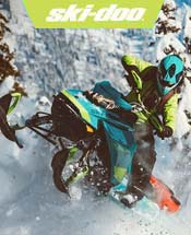 Teal and Yellow Ski-Doo Snowmobile.